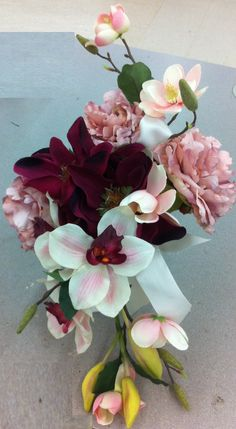 Cascading Elegant Pink Peonies, Burgandy Magnolias, Orchids and Cherry Blossom Bridal Bouquet. $89.00, via Etsy.