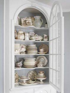 This dining room's built-in cupboards show off a transferware collection. #storageideas