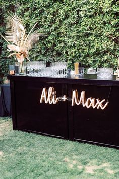 Modern Parker Palm Springs Wedding Cocktail Hour Bar with Neon Sign
