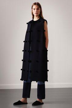 Le Fashion Blog Ports 1961 FW 2015 Minimal Long Pom Pom Vest Sleeveless Jacket Colorblock Cropped Jeans Black Slippers photo Le-Fashion-Blog-Ports-1961-FW-2015-Minimal-Long-Pom-Pom-Vest-Sleeveless-Jacket-Colorblock-Cropped-Jeans-Black-Slippers.jpg