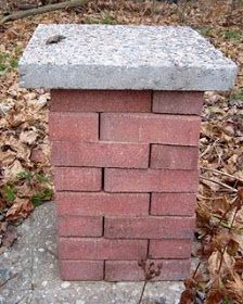 32 bricks topped by a paver stone. Could add a few more bricks for height. Set a shallow bowl on top for a bird bath.