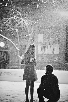 Pretty much how Ben proposed to me! In a blanket of snow, late at night with 700 white Christmas lights wound throughout the trees. <3