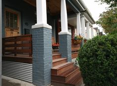 This is the front porch design of our Leslieville, Toronto project. After having completed most of the interior of the house, the exterior didn't really fit with the rest of the renovation. Front Porch Pillars, Front Porch Seating, Concrete Front Porch, Porch Wood, House Front Porch, Front Porch Design, Porch Columns, Porch Steps, Front Steps