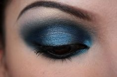 Blue eyeshadow with a hint of bronze on brown eyes