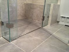 Curbless shower with a linear drain.
