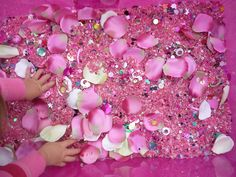 I'm so going back to the Dollar Tree to get those pink coins for when I make one of these tubs - Flowers and Fairies Sensory Tub