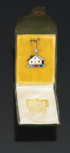 """Gem-set and diamond Acrostic pendent charm, Cartier, 1930s, designed as a house, embellished with a rose diamond, buff-top emerald, amethyst, ruby, emerald, sapphire and turquoise, spelling """"Dearest"""", signed Cartier, Made in France, numbered, French assay and maker's marks, case stamped Cartier Paris."""