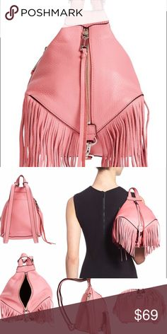 "'Mini Julian' Fringe Leather Backpack in Guava No rips. No stains. Comes with dust bag and extra tassels. Slightly glazed leather gets a fun boho twist from a lush panel of swingy fringe. Front and side zip closures.Top carry handle; adjustable shoulder straps. Interior zip, wall and smartphone pockets. Lined. Leather.  7 ½""W x 9""H x 5""D. 2 ½"" strap drop. 🚫Price Firm🚫No Trades🚫 Rebecca Minkoff Bags Backpacks"