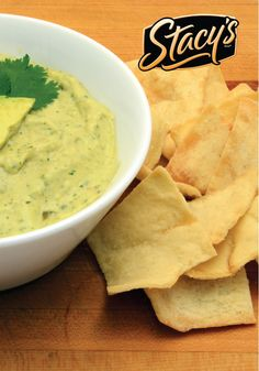 This Chile Verde Hummus dip recipe utilizes the creamy goodness of avocado to create the perfect appetizer when paired with STACY'S SIMPLY NAKED Pita Chips.