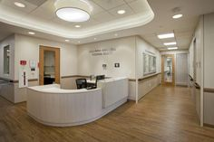 The openness of the nurses' station makes it feel friendly, while still allowing the nurse to perform multiple tasks such as filing, checking patients in and out of the facility, and monitoring the main, multipurpose, and treatment rooms. Photo: Adrian Tiemans Photography