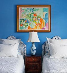This guest bedroom is wrapped in a dreamy cerulean paint. - Photo: Robert Brantley / Design: Robin Weiss