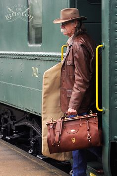 Col. Littleton No. 3 Leather Grip. Inspired by the bags carried by travelers of yesteryear. This travel bag is unique and certain to be a conversation piece everywhere you go. Handmade in our Colonel Littleton workshop, makes a great weekend bag. Made in the USA.