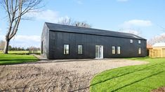 Stunning barn conversion at Bressingham by award-winning Nest Development   East Anglian Daily Times Barn House Conversion, Barn Conversion Interiors, Barn Conversions, Contemporary Barn, Modern Barn, Country Farmhouse Exterior, Steel Barns, House Cladding, Luxury Modern Homes