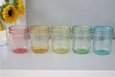 Use these colorfully tinted jars as lovely vases. Get the tutorial on Momtasic DIY.    - HouseBeautiful.com