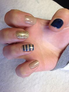 Tan with gold glitter accent nail navy accent nail and stripe design Oasis Salon and Spa Mill Hall Pa (570)726-6565
