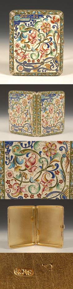 A Russian silver gilt and shaded cloisonne enamel cigarette case, by Feodor Ruckert, Moscow, circa 1896-1908. Rectangular in shape, the surface enameled with shaded cloisonne florals and leaf scrolls on a cream colored ground.