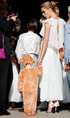 Cara Delevingne in Chanel -  Poppy Delevingne's wedding.  (May 2014)