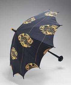 Parasol  Date: 1925–35 Culture: American (probably) Medium: silk, wood, metal, plastic Dimensions: 29 in. (73.7 cm)