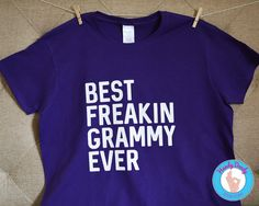"This fun tee is exactly what your grammy needs. Our made-to-order shirt features white lettering on a purple t-shirt. The text reads Best Freakin Grammy Ever.  All of our products are made to order with a professional heat press. If you'd like a different color combination (see image showing our options), include that info in the ""notes to seller"" section when you are making your purchase, otherwise shirt will be created as pictured.  Due to monitor/display settings and/or dye lots, colors…"