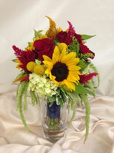 Tuscan inspired bridal bouquet of sunflowers, celosia, roses and craspedia. Designed by Rebekah at Ballard Blossom, Seattle Wedding Flowers, Seattle Florist.