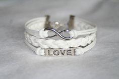 love bracelet, infinity bracelet, karma bracelet. Three strings together.  I love this!