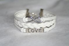love bracelet, infinity bracelet, karma bracelet. Three strings together. $6.99