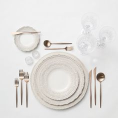 RENT: Lace Chargers/Dinnerware in White + Moon Flatware in Brushed Rose Gold + Czech Crystal Stemware + Antique Crystal Salt Cellars SHOP: Moon Flatware in Brushed Rose Gold