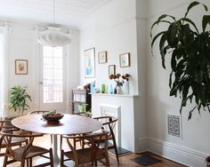 Contemporary Dining Room Idea In New York With White Walls And...