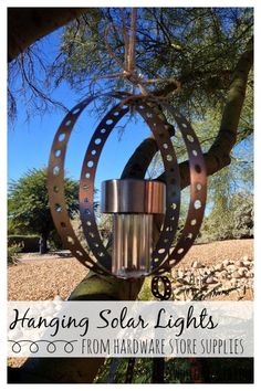DIY hanging solar lights in orb shape to light up a tree or for outdoor decor and entertaining. DIY home decor from hardware store supplies.