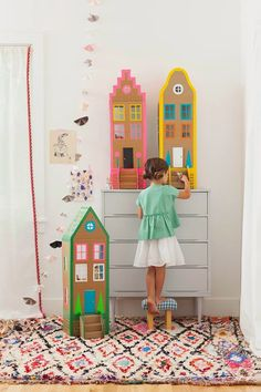 Build play houses with cardboard and colored tape.