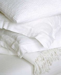 Look!  All White Bedroom With Warmth and Texture
