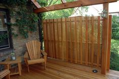 Private Outdoor Living with a Pergola and Lattice on a Cedar Deck traditional porch