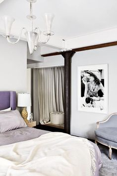 Bedroom with purple color scheme. I love all the shades present in this room and the beautiful chandelier