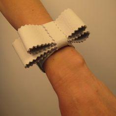 leather bow bracelet //  http://www.etsy.com/listing/62731381/white-leather-bowtie-bracelet?ref=v1_other_1