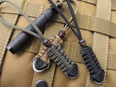 Tactical gear lanyards with black skull beads. Fit TAD Blackhawk & 5.11 and makes great knife lanyards. 66+ custom colors to choose from.