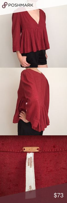 NWT Free People Red Clay Top NWT Free people high-low top. Red clay color trending this summer. Size small. 52% cotton 48% rayon. Beautiful fabric! Free People Tops Blouses