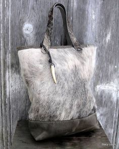 Hair On Cowhide and Distressed Leather Tote Bag in Grey Roan Hide via stacyleigh. Click on the image to see more!
