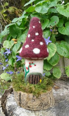 Check out this item in my Etsy shop https://www.etsy.com/uk/listing/248188460/needle-felted-toadstool-fairy-house