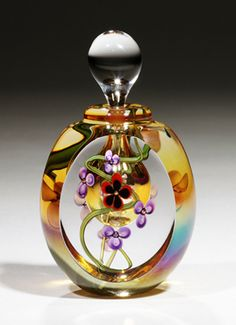 Elegant perfume bottle made by hand blown glass art by Roger Gandelman. Perfumes Vintage, Antique Perfume Bottles, Vintage Bottles, Vintage Makeup, Glas Art, Blown Glass Art, Beautiful Perfume, Bottles And Jars, Glass Bottles