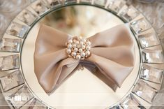I love the pearl brooch as the napkin ring!