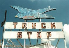 bluebird truck stop, atlanta, ga • not there anymore(sign still is though), first time I drove into Atlanta I went here - not big enough to cuss a cat in and hard to get back out of