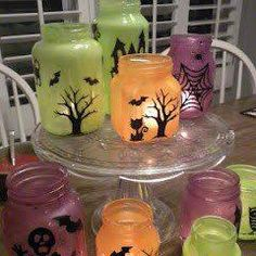Halloween Luminaries! Fun and beautiful craft to try with the kids! Just mix white glue and craft paint; paint the inside of glass jars; decorate outside of jar with vinyl cutouts or a permanent pen; add candle; Enjoy! : )