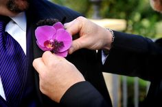 Mens boutineer is a purple orchid