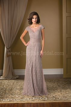 Jasmine Bridal Mother of the Bride/Groom Dress Jade Couture Style K178007 in Light Pale Purple/ Pink.  A glamorous and extravagant gown to make a statement at your next event. This soft tulle dress has a boat neckline, A-line skirt, and is covered in a layer of beautiful lace touched up with beading along the neckline.