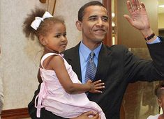 President Barak Obama With Daughter Sasha Obama. Link features multiple pictures of them together.
