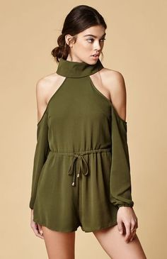 Modern and sophisticated, the Brooks Cold Shoulder Romper easily takes you from the office to happy hour. This green cold shoulder romper is made from lightweight poly for comfy, all-day wear, while a buttoned turtleneck offers warmth.   Unlined Buttoned turtleneck Cold shoulder design Beaded drawcord at the elastic waistband; Concealed back zip closure Model is wearing a small Model's measurements: Height: 5'9'' Bust: 32'' Wai...