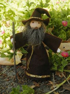 This wise old wizard is the perfect addition to castle play. Hand painted and hand stitched of natural materials, with wonderful attention to detail. He wears a soft brown wool felt robe with a pointe