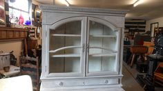 Contintental glass fronted wall cabinet. www.at-the-cartshed.co.uk. For sale at the Holt Antiques and Interiors centre
