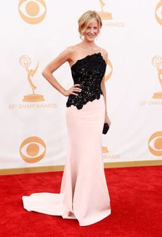 Actress Anna Gunn arrives at the 65th Annual Primetime Emmy Awards wearing a floor-length Romona Keveza dress