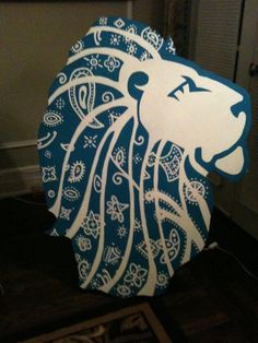 Wooden lion. Have them cut and you can paint them for an Alpha or Sisterhood event!